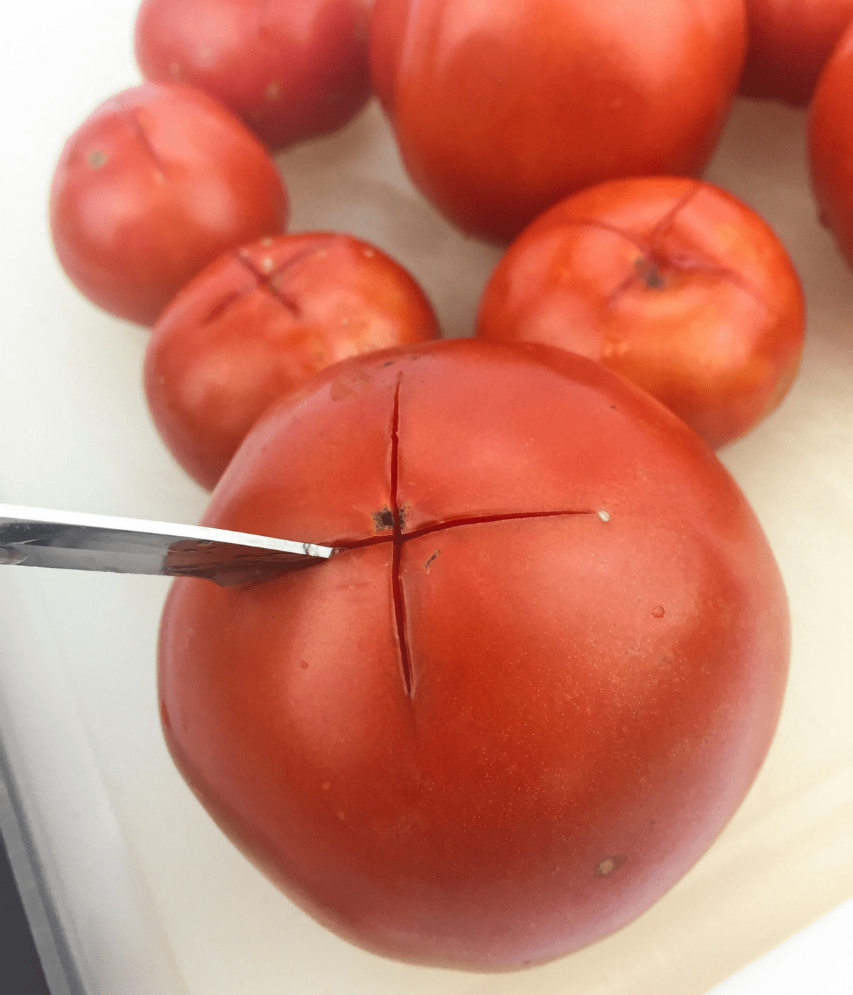 Learn how to make tomatoes safe to eat for lectin free, Paleo, and AIP diets through this peeling and de-seeding method.