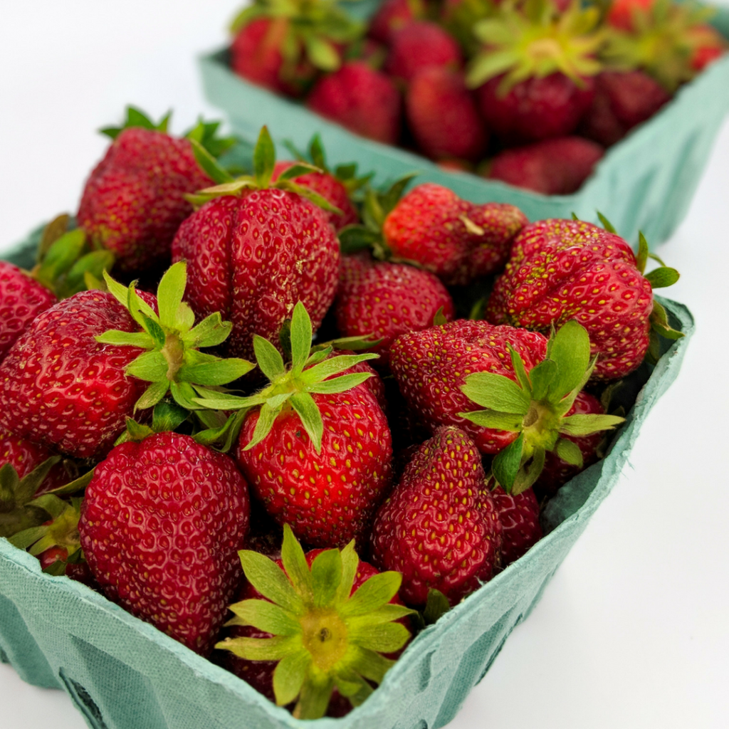 Fresh, local strawberries in the box.